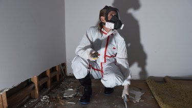 Jeanette Williams, a building biologist with EcoLibria, tests a home in Sydney's north for dangerous mould.