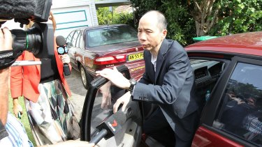 Robert Xie arrives home in December 2015 after his third trial
