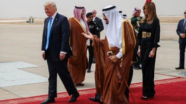 President Trump and Melania Trump are welcomed by King Salman at King Khalid International Airport.