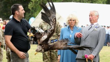 Prince Charles, Prince of Wales and Camilla, Duchess of Cornwall react as bald eagle Zephyr), mascot of the Army Air Corps flaps his wings last week.