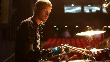 Drummer Jason Barnes with his prosthetic arm which allows him to drum faster than any other human.