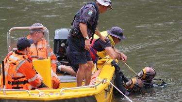 Police divers search the Murrumbidgee River in Wagga on Thursday.