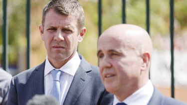 Education Minister Adrian Piccoli (pictured with Premier Mike Baird, left) will announce on Friday that the budget will double current funding for independent schools.