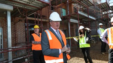 New for old: Brad Hazzard at the site of public housing construction in Lurnea.