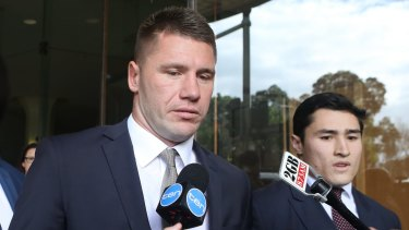 Tough times: Former Sydney Roosters player Shaun Kenny-Dowall leaves Downing Centre Court after pleading guilty of drug possession.