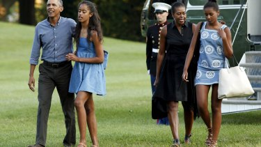 U.S. President Barack Obama, walks with Malia, First lady Michelle and Sasha.