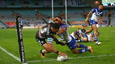 Touchdown: Valentine Holmes scores a try as he is tackled by William Hopoate on Monday night.