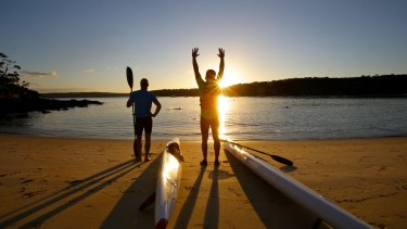 Early morning ski paddlers about to enter the water at Balmoral Beach.