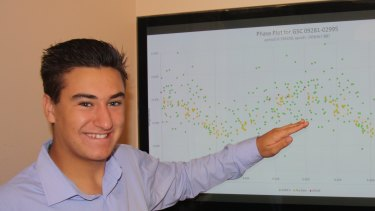 Will Stamp pointing to the light curve he spotted, which revealed the variable star.