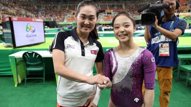 South Korean gymnast Lee Eun-ju, right, and her North Korean counterpart Hong Un-jong during the artistic gymnastics women's qualification at the 2016 Summer Olympics in Rio de Janeiro, Brazil.