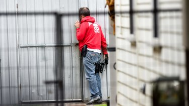 Police executing a search warrant in Footscray on Tuesday.
