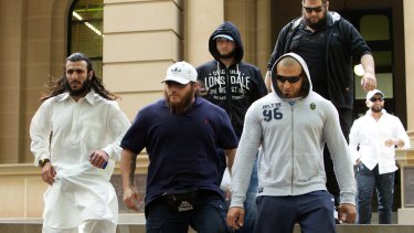 Mohamed Elomar (left) and Khaled Sharrouf (second from left) attend Ahmad Elomar's court appearance in 2012.