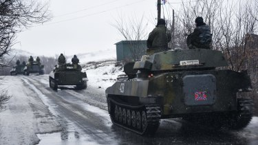 A pro-Russian armoured vehicle moves towards eastern Ukraine.