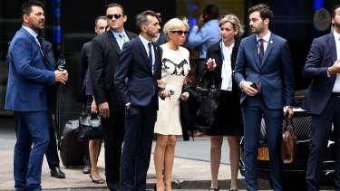 Brigitte (centre) in New York with aides Pierre-Olivier Costa (to her left) and Tristan Bromet (closest at her right).