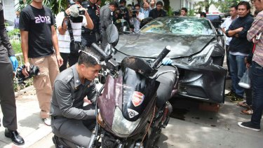 The Ferrari that was driven by Vorayuth Yoovidhya and a motorcycle, both involved in an accident, are displayed by police in Bangkok, Thailand.