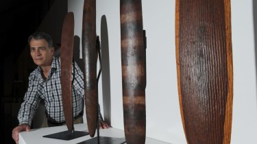 CMAG assistant director Mark Bayly with indigenous wood carvings in the Punuku Tjukurpa exhibition.
