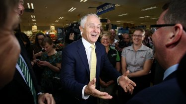 Prime Minister Malcolm Turnbull with a spring in his step on Tuesday morning at a Brisbane Mitre 10 store. Woz his dinner wot dun it.