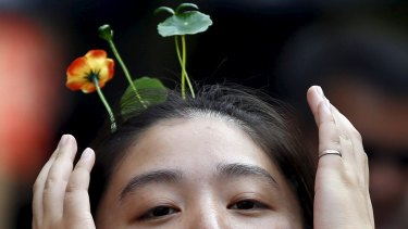 Sprouts, flowers, vegetables worn in the hair: China's new reaction to the bleak landscapes of many of the nation's cities.