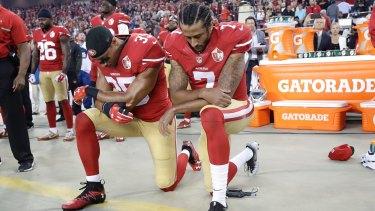 San Francisco 49ers safety Eric Reid and quarterback Colin Kaepernick kneel during the national anthem.