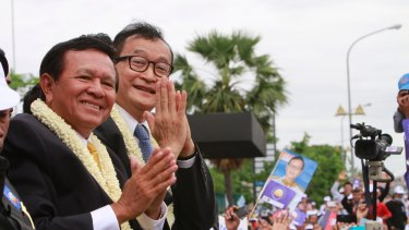 Opposition leader Kem Sokha, left, with his ill-fated predecessor Sam Rainsy in 2013.