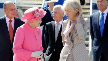Queen Elizabeth chats to Elizabeth Chernov on the monarch's arrival at Melbourne Airport on October 26, 2011. The Duke of Edinburgh, left, Victorian Governor Alex Chernov and Premier Ted Baillieu are behind them.