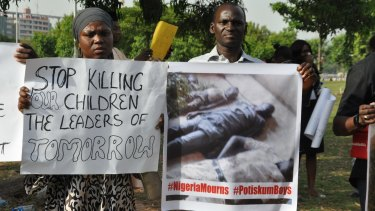 The death continues: A group protests an earlier tragedy, when a bomber killed 27 students inside school grounds in Potiskum, Nigeria.