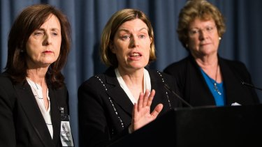 Dr Kerry Chant (centre) at a press conference earlier this month to deliver the interim report.