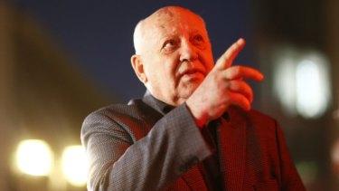 Architect of reform: Former Soviet president Mikhail Gorbachev at Checkpoint Charlie.