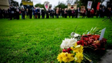 Flowers were laid in memory of those who served in WWI during the descendants' service.