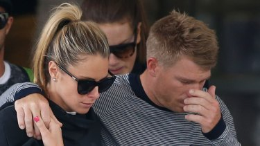 David Warner, accompanied by his wife Candice Falzon cries as he leaves the hospital on Thursday.