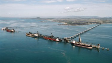 Coal carriers are loaded near Mackay. Australian exporters are sure to be hurt by China's current go-slow.