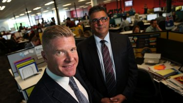 Acquire Learning Group Managing Director John Wall and the company's former advisory council chair Andrew Demetriou in November 2014.