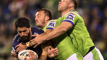 Close encounter: Storm prop Jesse Bromwich is tackled by Raiders hooker Josh Hodgson.