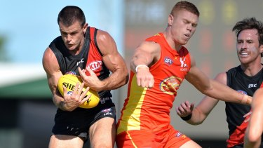 Essendon's Brent Stanton takes a mark against the Gold Coast.