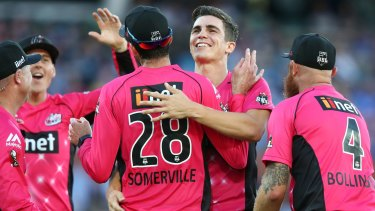 Sixers players celebrate with star bowler Sean Abbott.