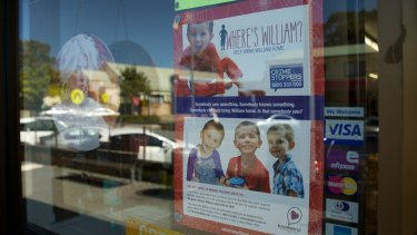 A poster in a Laurieton shop window about missing toddler William Tyrrell.