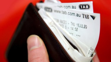 Tabcorp spent $54 million in the past financial year on its merger bid with Tatts.