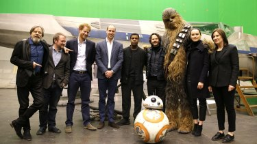 Royal visit ... from left, Mark Hamill (Luke Skywalker), director Rian Johnson, Prince Harry, Prince William and British actor John Boyega (centre) pose with Chewbacca and British actress Daisy Ridley at Pinewood Studios.