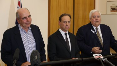 Environment Minister Greg Hunt with Bernie Fraser, left, and Clive Palmer, right.