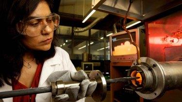 Professor Veena Sahajwalla adding alloys to the micro-furnace at UNSW SMaRT centre.