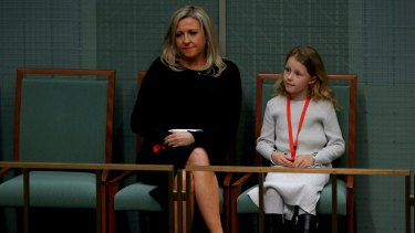Mrs Bishop's family listening to the former speaker deliver her valedictory speech.
