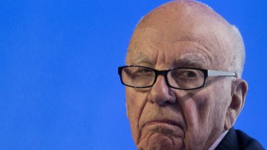 Low interest rates and governments printing money push up the price of assets, rewarding the wealthy owners of assets, Mr Murdoch told his high-powered audience.