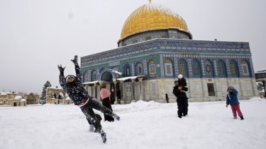 Snowball fights in front of the Dome of the Rock in Jerusalem's Old City.
