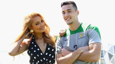 Australian singer and DJ Havana Brown poses with Socceroo Jason Davidson after a Socceroos training session at Collingwood training ground on Sunday.