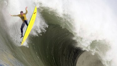 Huge waves ... Ion Banner catches air just before wiping out during the first heat of the Mavericks Surf Contest near Half Moon Bay, California in 2010.