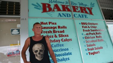 Ross Paull, standing outside the Box Village Bakery and Cafe, said his family became ill.