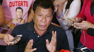 Presidential front-runner Rodrigo Duterte answers questions from the media.