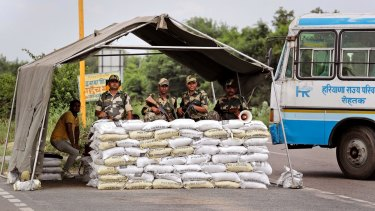 Indian Para-military force soldiers stand guard near Sunaria Jail where Gurmeet Ram Rahim Singh is lodged.