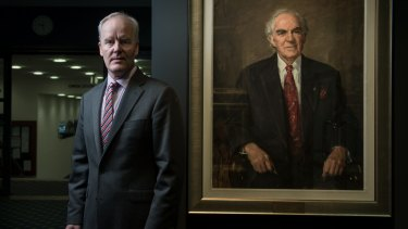 Michael McGarvie, Victorian Legal Services Commissioner, with a portrait of his late father Richard McGarvie who as a judge in 1984 heavily criticised the governance of the Supreme Court of Victoria.