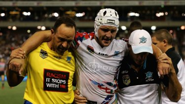 Jarrod Croker of the World All Stars is injured during the match.